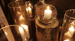 White candles in glass vases Stock Footage