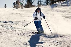 Man skiing on slope - winter holidays Stock Photos