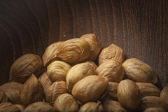 Hazelnuts close up of on a wooden bowl - stock photo