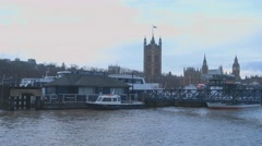 River Thames London with Houses of Parliament Westminster Stock Footage