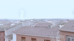 Rooftops with smokey chimneys - stock footage