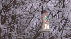 Vintage Christmas ornament hanging on hoarfrost covered shrub branch outdoors Stock Footage