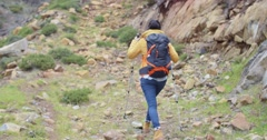 Rear view of an active female hiker Stock Footage