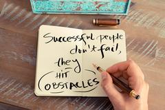 Handwritten text SUCCESSFUL PEOPLE DON'T FAIL - stock photo