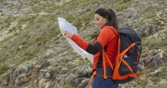 Young woman out hiking checking a map Stock Footage