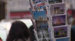 Postcards of Paris on a stand Stock Footage