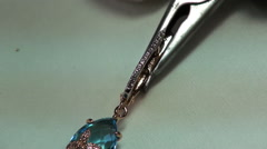 Painting gems acid in jewelry. - stock footage
