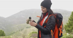 Thirsty young woman backpacker - stock footage