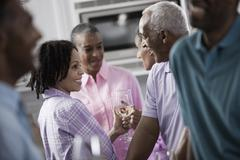 Baby boomer generation group having a party. Men and women. Stock Photos