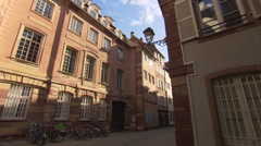 Strasbourg street corner in historic city center with Pedestrian passing Stock Footage