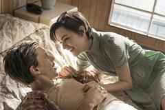 A young couple in a motel room. - stock photo