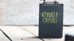 The words Refugee crisis Stock Footage