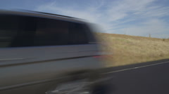 Left Front Three Quarter view of a Driving Plate: Car travels east along the Stock Footage