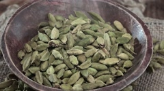 Portion of rotating Cardamon Seeds (seamless loopabe; 4K) Stock Footage