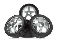 Wheels with new tires on white background - stock illustration