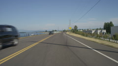 Front view of a Driving Plate: Car travels east on NE Marine Drive in Portland, Stock Footage