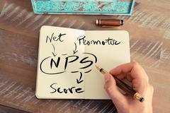 Handwritten text NPS NET PROMOTER SCORE - stock photo