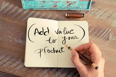 Handwritten text ADD VALUE TO YOUR PRODUCT - stock photo
