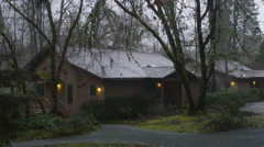 Zoom-in on one of two guest cabins  in the rain at a resort near Grants Pass, - stock footage