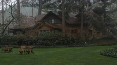 Zoom-in on rustic lodge in the rain near Grants Pass, Oregon - stock footage
