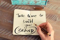 Handwritten text TAKE TIME TO BUILD YOUR BRAND - stock photo
