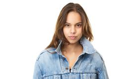 Horizontal portrait of an attractive young woman in jeans jacket Stock Photos