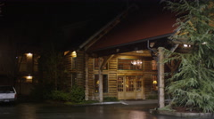 Entrance of a rustic lodge at night in Grants Pass, Oregon Stock Footage