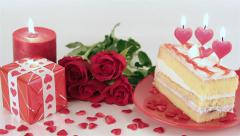 Decorated cake with candles and roses for Valentine's Day - stock footage