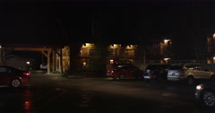 Motel lodge parking lot at night in Grants Pass Oregon Stock Footage