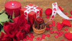 Chocolate cupcake with roses and gift on wood - stock footage