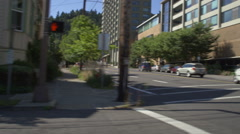 Left Side view of a Driving Plate: Car is driving down Broadway Street in Stock Footage