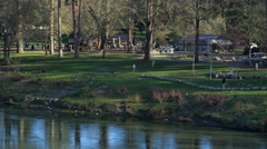 Park next to Rogue River near Grants Pass, Oregon Stock Footage
