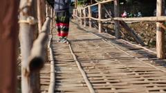 Woman walking at bamboo bridge Stock Footage