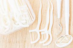 Oral Device : A box of white dental floss on wooden background Stock Photos