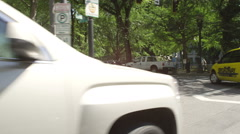 Left Front Three Quarter view of a Driving Plate: Car travels along Madison Stock Footage