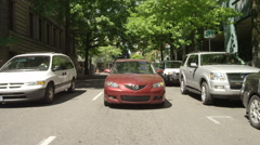 Rear view of a Driving Plate: Car travels along Madison Street from its Stock Footage