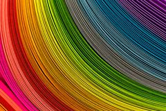 Paper strips in rainbow colors as a colorful backdrop - stock photo