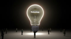 Typo 'Technology' in light bulb and surrounded businessmen, idea concept version - stock footage