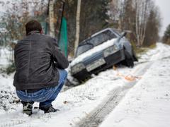 Man crushed his car into the ditch Stock Photos