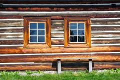 Facade of the old wooden house - stock photo
