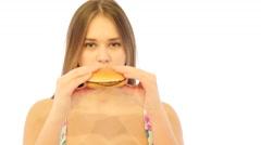 Girl Bites Hamburger and Feel Bad Stock Footage