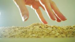 Beautiful woman hand scooping rolled oats, slow motion video Stock Footage