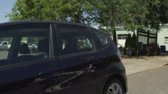 Left Rear Three Quarter view of a Driving Plate: Car turns left onto SE Ankeny Stock Footage