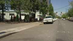 Rear view of a Driving Plate: Car turns left onto SE Ankeny Street in Portland, Stock Footage