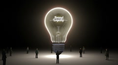 Typo 'Brand loyalty' in light bulb and surrounded businessmen, idea concept Stock Footage