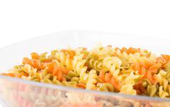 Raw fusilli pasta - three colors - stock photo