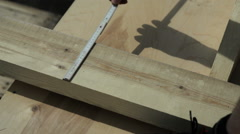 Man measuring a wooden block Stock Footage