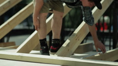 Man measuring a wooden structure Stock Footage