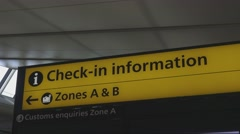 Check In sign at London Heathrow Airport - stock footage