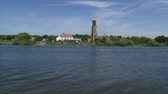 Skyline Rhenen at the north bank of the river Rhine + pan Stock Footage